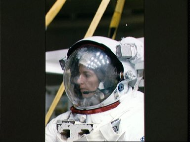 STS-32 MS Dunbar fully suited in EMU with helmet prepares for WETF exercises