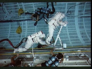 STS-37 crewmembers work with CETA during EVA training in JSC's WETF