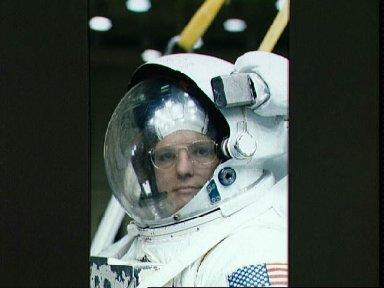 STS-31 MS Sullivan in EMU prepares for JSC EVA simulation in the WETF pool