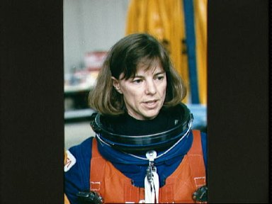 STS-32 MS Dunbar wearing LES prepares for WETF water egress training