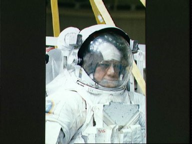 STS-31 Mission Specialist (MS) McCandless in EMU prior to JSC WETF simulation