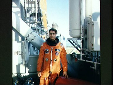 STS-33 Pilot Blaha on KSC LC Pad 39B 195 ft level with OV-103 in background