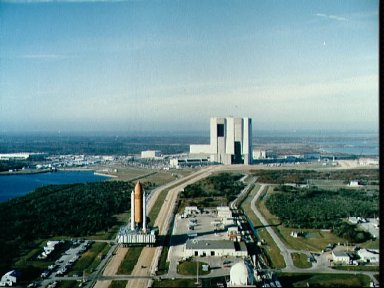 STS-36 Atlantis, OV-104, leaves VAB during its rollout to KSC LC Pad 39A
