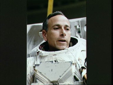 STS-38 Mission Specialist (MS) Carl J. Meade during EMU donning in JSC's WETF