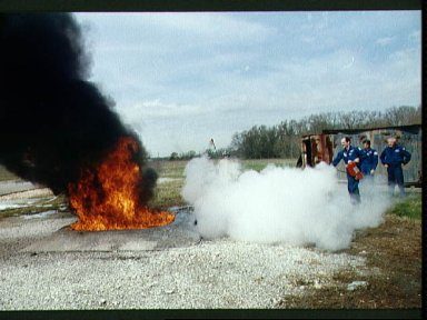 STS-35 Pilot Gardner during fire fighting exercises at JSC fire training pit
