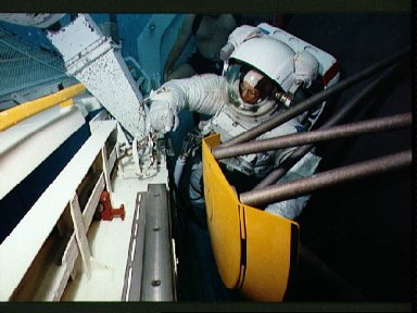 STS-31 MS McCandless, in EMU, during EVA underwater simulation in JSC's WETF