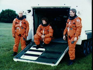STS-31 crewmembers, wearing LESs, in M113 tracked vehicle during TCDT at KSC