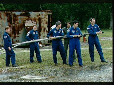 STS-41 crewmembers participate in fire fighting exercises at JSC