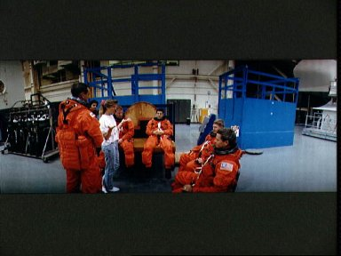 STS-41 crew listens to JSC trainer's instructions prior to egress exercises