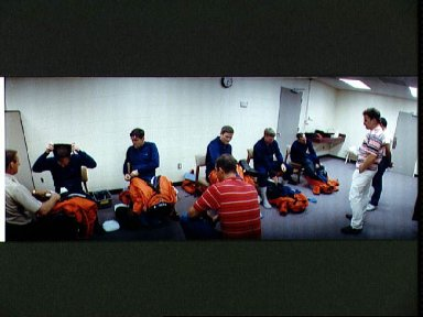 STS-41 crewmembers don LESs prior to emergency egress training in JSC's MAIL