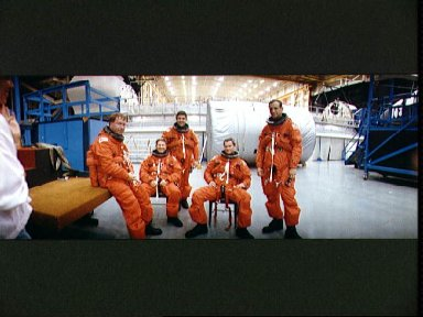 STS-41 crewmembers take a break from emergency egress training in JSC's MAIL