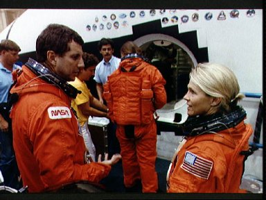 STS-40 crewmembers prepare for emergency egress training in JSC's MAIL