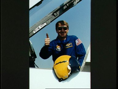 STS-38 Pilot Culbertson gives thumbs up from T-38A at Ellington Field