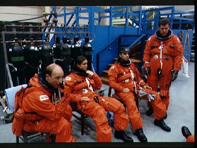STS-40 crew waits for emergency egress training to begin at JSC's MAIL FFT