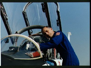 STS-38 MS Meade checks T-38A paperwork at Ellington Field prior to departure
