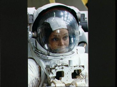 STS-40 MS Jernigan wearing EMU prepares for a simulation in JSC's WETF pool