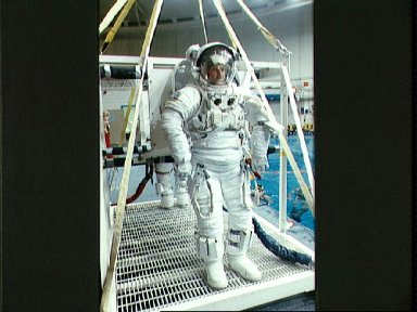 STS-45 MS Foale in EMU prepares for underwater exercises in JSC's WETF pool