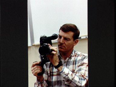STS-44 Mission Specialist (MS) Voss holds ARRIFLEX camera during JSC training