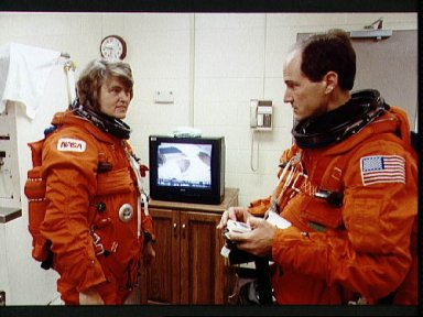 STS-43 crewmembers discuss procedures prior to training in JSC's MAIL Bldg 9