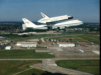 Air to air view of Endeavour, OV-105, atop SCA approaches Ellington runway