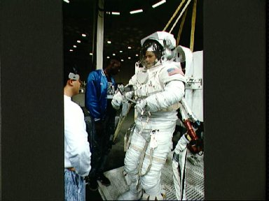 STS-49 Mission Specialist (MS) Hieb prepares for EVA simulation in JSC's WETF