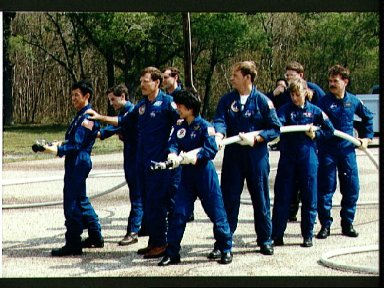 STS-47 crewmembers and backups during JSC fire fighting exercises