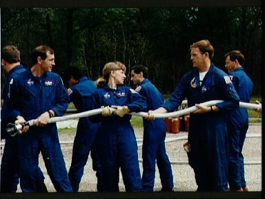 STS-47 crew during JSC fire fighting exercises in the Fire Training Pit