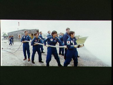 STS-47 crew during fire fighting exercises at JSC's Fire Training Pit