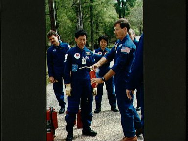 STS-47 Commander Gibson with fire extinguisher during JSC fire training