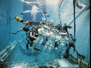 STS-49 INTELSAT VI-R WETF exercise with astronauts Musgrave, Clifford, Voss