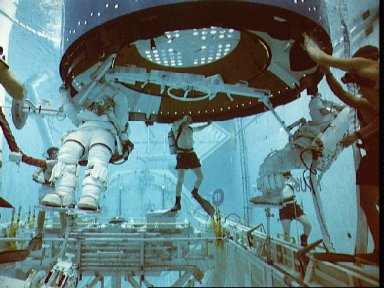 STS-49 INTELSAT VI-R WETF exercise with astronauts Musgrave and Clifford