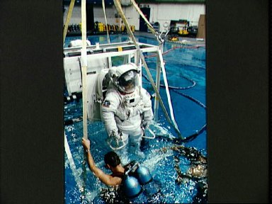 STS-57 MS2 Sherlock in EMU is lowered into JSC's WETF pool for EVA simulation