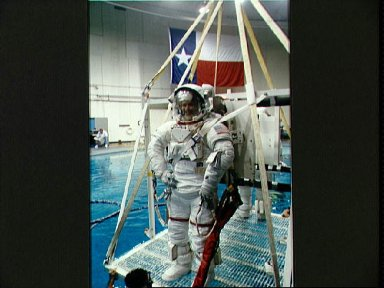 STS-57 MS3 Wisoff in EMU is lowered into JSC's WETF pool for EVA simulation