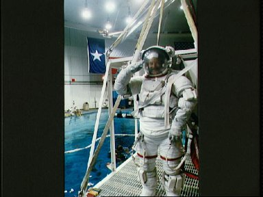 STS-53 MS Voss, in EMU, is lowered into JSC's WETF pool for EVA simulation