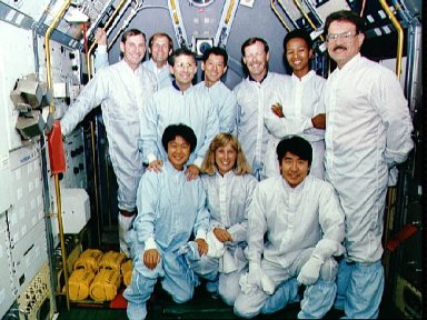 STS-47 crew and backups pose for portrait in SLJ module at KSC during training