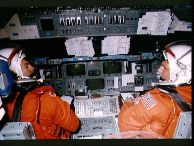 STS-56 Commander Cameron and Pilot Oswald on CCT flight deck in JSC's MAIL