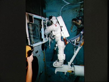STS-61 crewmembers in the WETF rehearsing for HST repair mission