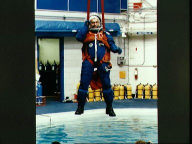 Cosmonaut Vladimir Titov participates in bail-out training for STS-60