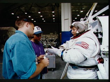 Astronaut Wendy Lawrenc during EVA training in the WETF