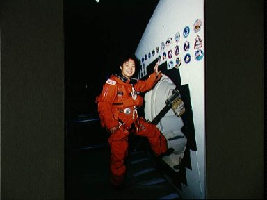 STS-65 Japanese Payload Specialist Mukai at CCT side hatch during training