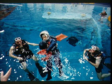 STS-65 Payload Specialist Mukai floats in WETF pool during bailout training