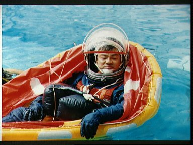 STS-65 Mission Specialist Chiao floats in a single person raft in JSC's WETF