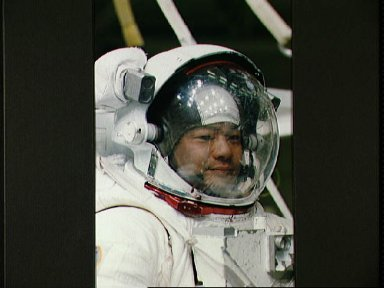 STS-65 Mission Specialist Chiao in EMU prepares for WETF contingency EVA