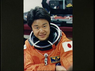 STS-65 Japanese Payload Specialist Mukai prepares for MAIL egress training
