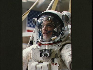 Astronaut Scott Parazynski is prepares to be submerged in the WETF
