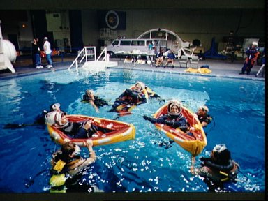 STS-67 crewmembers during emergency bailout training in WETF
