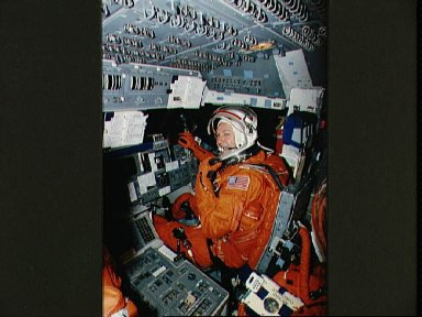 Astronaut Curtis Brown on flight deck mockup during training