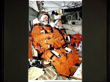 Cosmonauts Solovyev and Budarin check out recumbent seats for STS-71