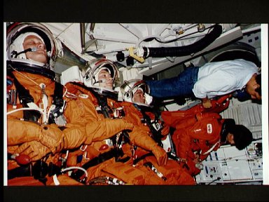 STS-71 cosmonauts and astronauts examine recumbent seats for STS-71