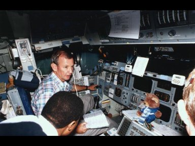 Astronauts Brian Duffy, in commander's seat, and Winston E. Scott discuss their scheduled flight aboard the Space Shuttle Endeavour.
